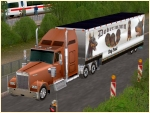 Kenworth-Truck bronze mit Trailer Dobermann